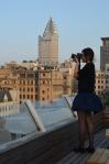 Nova photographing the Pudong skyline from Captain's Hostel Roof Bar